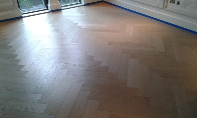 Sanded and sealed parquet flooring.